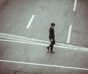 Young Professional in Street Alone